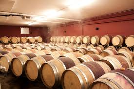 stacked oak barrels maturing red wine. Download Wine Barrels In Cellar. Cavernous Cellar With Stacked Oak B Stock Image - Maturing Red