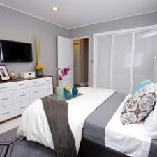 bedroom with tv. Gray And White Master Bedroom With Wall Mounted TV Tv M