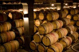stacked oak barrels. Many Oak Wine Barrels Stacked In A Winery Barrel Cellar