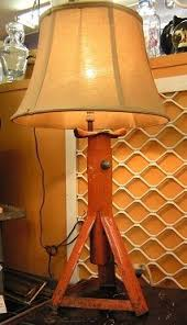 into lighting. car jack turned into a lamp this is soo cool would love to make lighting