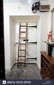 a short wooden ladder stored in a corridor to allow inspection of a short wooden ladder stored in a corridor to allow inspection of a home s fuse box and electricity meter uk