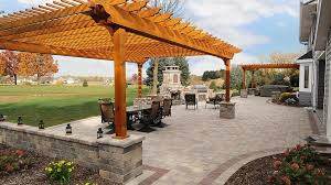 paver patio with pergola. Photo Of Integrity Landscape Services - New Berlin, WI, United States. Large Brick Paver Patio With Pergola