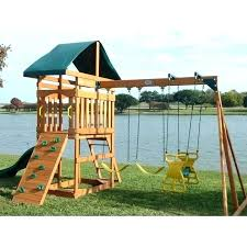 swing sets at menards wooden set with glider kids outdoor wood canopy 2 swings rock anchors