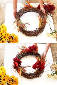 secure each bouquet by tucking the stem into the gvine wreath