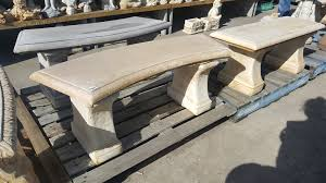 plain curved concrete bench seat pots
