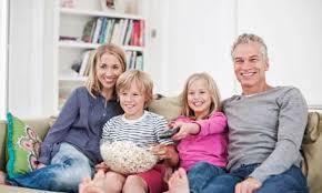 family watching tv at night. family watching tv tv at night n