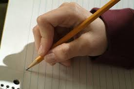 the sat essay how to plan and prepare for it peterson s blog hand grasping pencil about to write