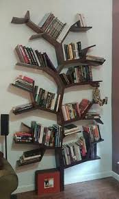 Tree bookcase filled with books. Made by my neighbor.