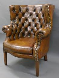 a georgian revival leather upholstered barrel back chair