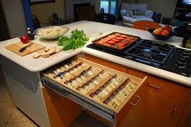 Place all the spices align on an inclined rack in the drawer near the stove.
