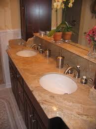 Black Granite Countertop And Silver Steel Sink On Top Brown Wooden ...