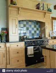 Cream Floor Tiles For Kitchen Blue Green And Cream Ceramic Tiles Above Black Range Oven In