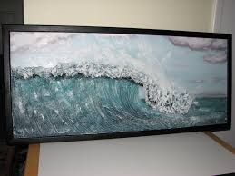 painted and framed wave sculpture drywall art