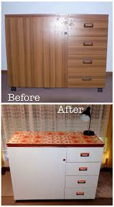 painted horn sewing cabinet with some decent primer copper spray retro wallpaper my drab wood grain laminate sewing cabinet is now a pretty piece of