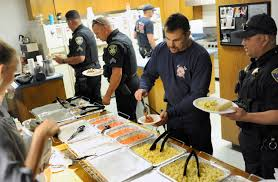 vacaville firefighters and police serve themselves lunch provided by olive garden at the south orchard avenue fire station on monday