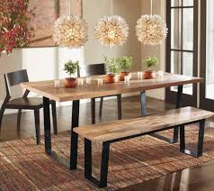 rustic dining room design with rectangular railroad tie dining room table black finish metal frame solid wood dining bench and capiz lotus hanging pendant