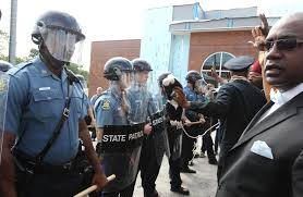 reasons why black cops are just as or more likely to propagate protesters are greeted by a wall of police officers after a to the ferguson police