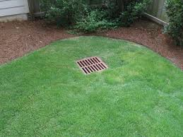 landscaping drainage around house round designs