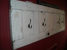 white door transformed into a coat rack with a rustic scandinavian look