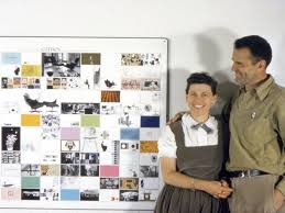 the eames office. (Charles And Ray Eames With A Panel Of Office Work Made For The American