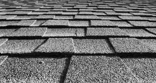 coated roofing shingles could help keep homes cool and might even cut urban ozone levels