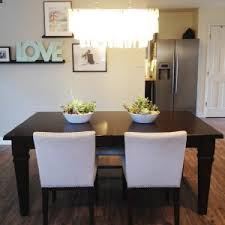traditional dining room wall decor ideas. Traditional Dining Room Decoration With Capiz Chandelier Plus White Wall Also Wooden Table Sets Ideas Decor E