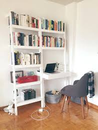 leaning bookshelf with desk bookcase desktop background a crisply cool scandi inspired apartment in toronto house call bookcase with desk ikea