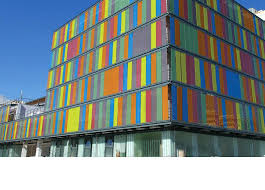colored glass building envelope motorized shades panels
