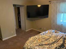 blank space around under wall mounted tv