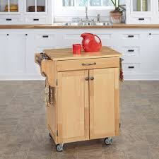 portable movable small mini kitchen island wood table white drawer cabinet knobs sink stainless steel faucet windows red cup unique teapot wheels rolling