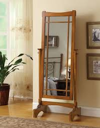 Warm oak finish wood mission style free standing cheval bedroom dressing  mirror . Measures 25