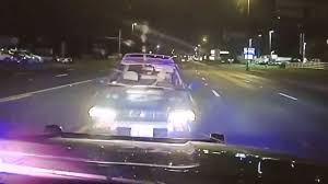 Sun Visor Police Lights See Alleged Drunk Driver Run Into Cop Car On Wrong Side Of Road