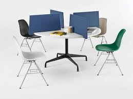 blue personal side screens affixed to a round table transform the surface into four wedge