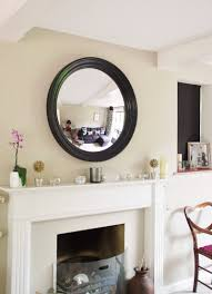 convex mirror black large roma hanging a round mirror above a fireplace image