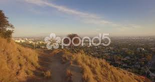 aerial flying backwards hollywood hills scenic view los angeles