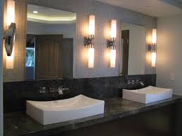 bathroom sconces. bathroom ideas, modern wall sconces with raised sink vanity under two large frameless