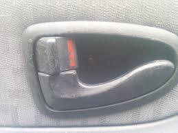picture of unhooking the interior door handle