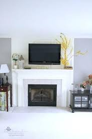 hiding tv wires over fireplace and hide the wires without putting them inside a hide flat screen tv wires over fireplace