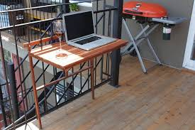 Foldable balcony table used as an outdoor workspace
