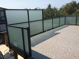 deck railings with frosted glass and black aluminum frame with privacy wall