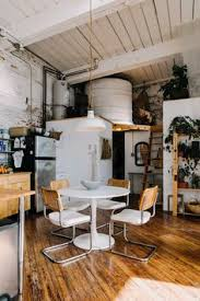a stunning loft apartment in an old textile factory the kitchen table is from ikea and the dining chairs