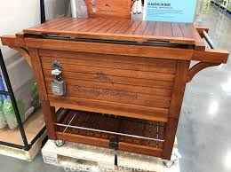 keep drinks cool for an outdoor gathering with the tommy bahama wood rolling cooler