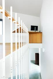 Up, the suspended staircase with its unique stretched and graphic lines.  The staircase from Jo-a offer an added value to the rooms they are in.