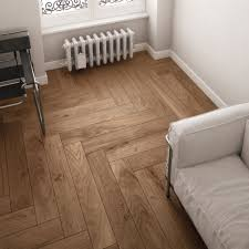 the herringbone pattern in wood look ceramic tile takes advantage of its uniform size