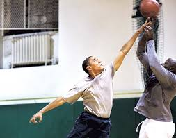the audacity of hoop author talks basketball and obama books  click to enlarge president barack obama playing basketball personal aide reggie love courtesy of pete souza
