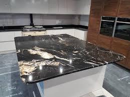 30mm titanium gold granite island with 30mm premium black granite worktops