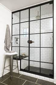 subway tile shower with black door frame