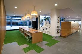 green office ideas. Warm Hang Lamp On The White Ceiling Inside Green Office Buildings It Also Has Wooden Cabinet Ideas D