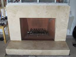 marble tile face fireplace and raised hearth