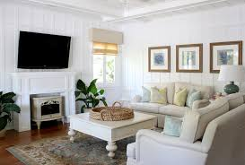 wall mounted electric fireplace living room traditional with beach beach theme beige couch beige sofa